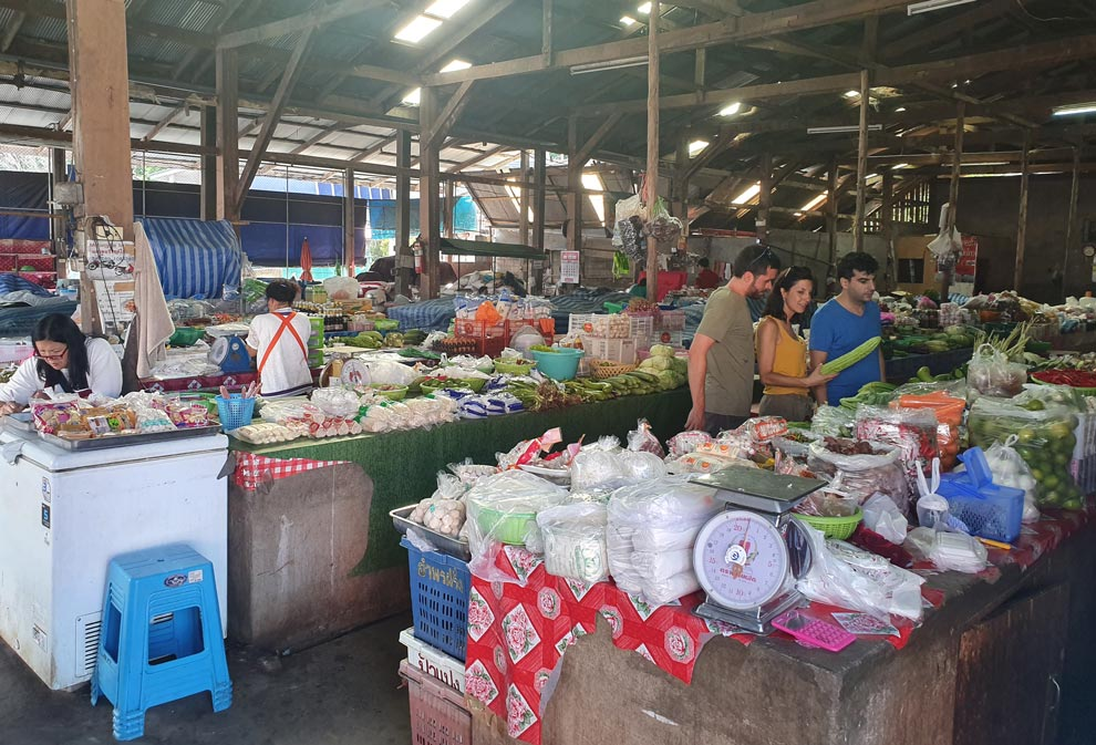 Selling products at the market in Mae Salong
